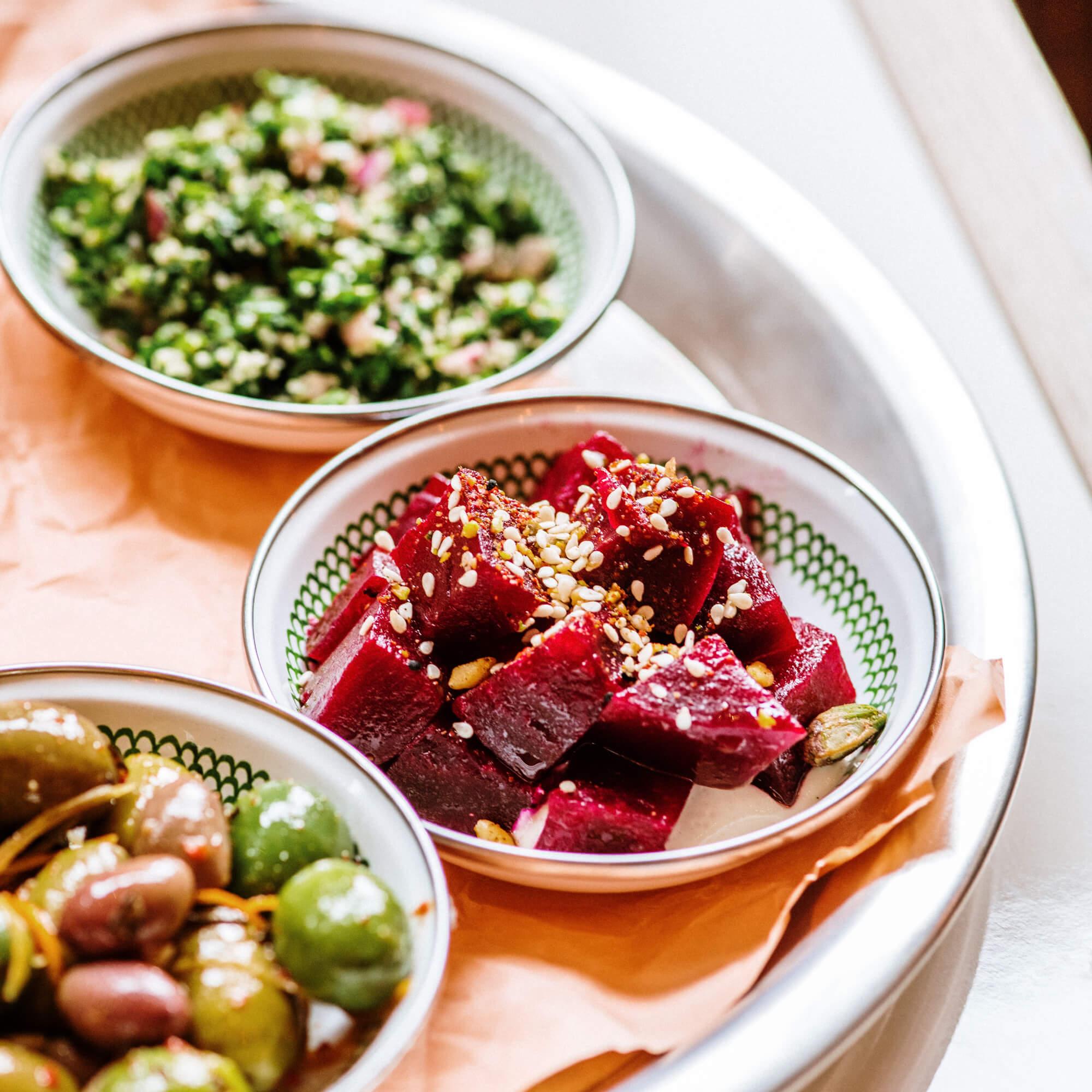 three bowls of side dishes at rina kitchen
